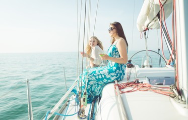 two beauiful girls on the boat enjoying the sun