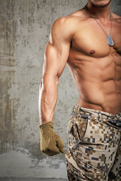 Man in army pants and naked body