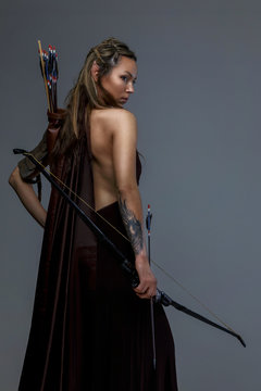Fighter woman in armor witj bow