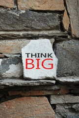 Think Big message written on a white stone