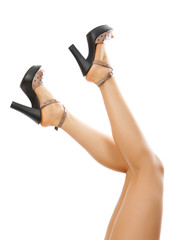 Sexy female feet with shoes raised up. isolated