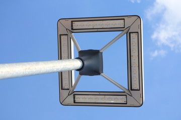 A street lamp with blue sky in the background