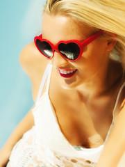 Beautiful blonde girl on sandy beach, portrait