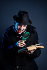 Detective with magnifier glass and book