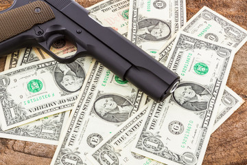 Close up money with gun.