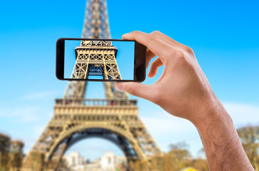 Hand holding Smartphone in Paris, France