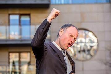 Businessman expresing his joy