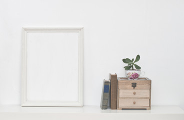 Empty picture frame and flowers