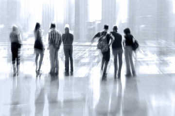 abstract image of people in the lobby of a modern business cente