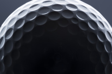 Poster Golf Macro shot of golf ball with light and shadow.