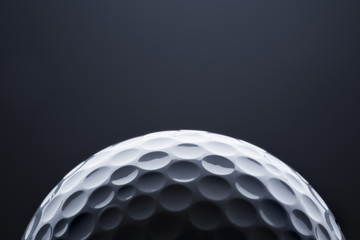 Papiers peints Golf Macro golf ball on dark blue background, space for text.