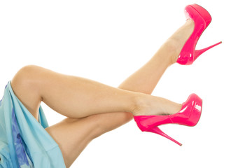woman legs up and crossed in blue skirt and pink heels