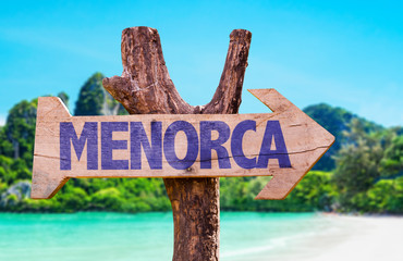 Menorca wooden sign with beach background