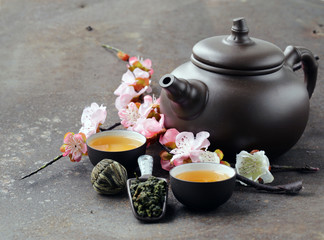 tea set (teapot, cups and different green tea)