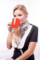 Beautiful business woman drinking a cup of coffee, tea