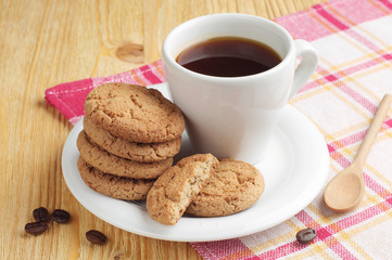 Plate with coffee and oatmeal cookies