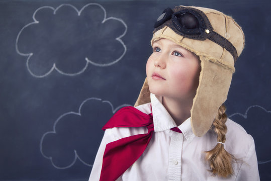 young girls with aviator goggles and hat
