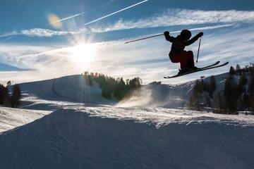 Keuken foto achterwand Wintersporten Little skier performs jump in the snow, silhouette