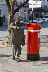 Newspaper boy statue