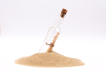 Isolated message in a bottle on white background
