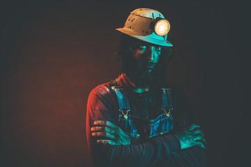 Portrait of Bearded Miner Wearing Helmet Lamp
