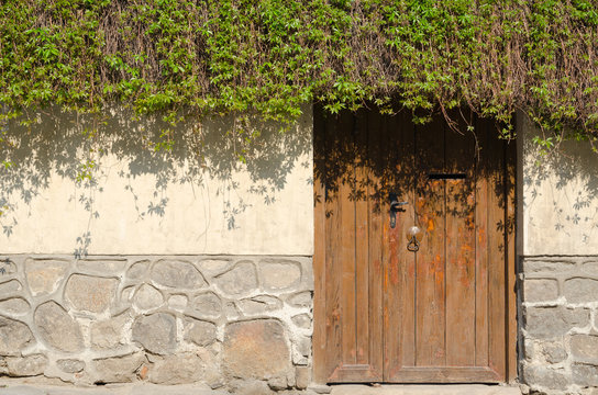 Old stone wall and wooden door, Plovdiv, Bulgaria