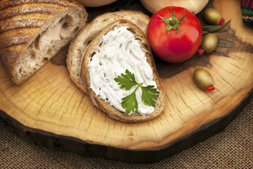 Delicious organic cream milk cheese, olives and home-made bread