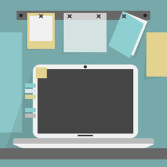 Open laptop on the desk on cubicle background wall
