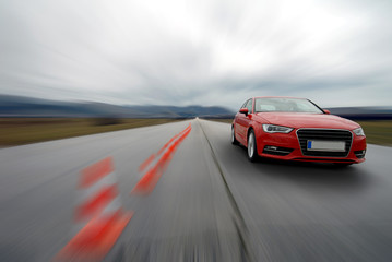 red car driving to fast