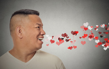 man sending kisses, red hearts coming out of open mouth