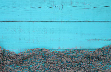 Fish net border on blank teal blue wood sign