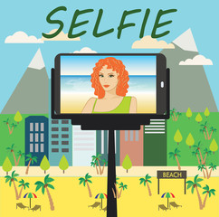 Woman makes selfie using a monopod and a smartphone