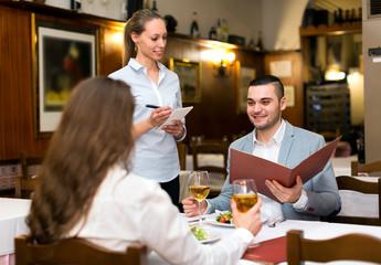 Family couple in restaurant