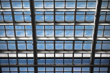Mirror roof of  modern building with blue sky