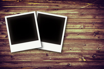 Photo frames on vintage wooden board background texture