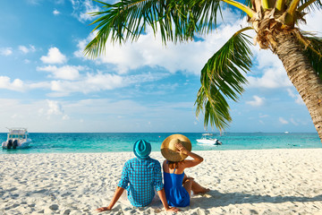 Couple in blue clothes on a beach at Maldives