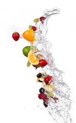 Mix of fruits with water splashes on white
