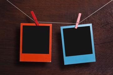 Two color polaroid frames on a clothesline