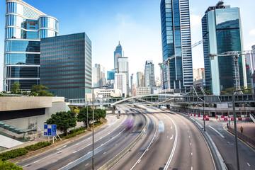 traffic and buildings at modern city hong kong during daytime.