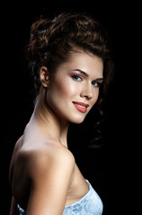 Beautiful brunette woman with evening make-up and hairstyle