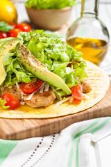 Chicken Tostados. Tortilla with chicken, lettuce and avocado