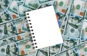 notebook  on dollar background