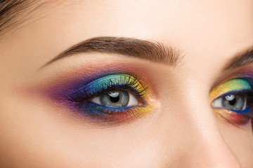 Close-up view of blue female eye with beautiful modern creative