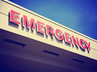 the front entrance sign to an emergency room department in a cit