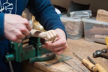 Sicilian puppets' artisan at work