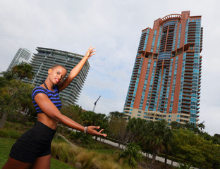 Woman showcasing a building