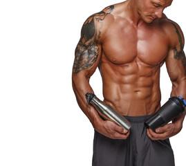 Muscular man holdink sport drinks