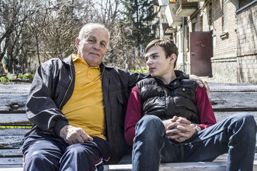 grandson of a teenager with his grandfather