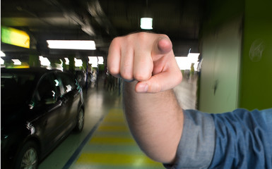 Man pointing  in the parking garage