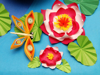 Composition of origami, dragonfly, water lily